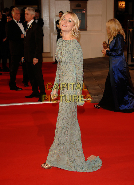 SIENNA MILLER.Red Carpet Arrivals at The Orange British Academy Film Awards (BAFTA's) held at the Royal Opera House, Covent Garden, London, England, February 11th 2007..full length grey gold beaded long sleeved dress.CAP/PL.©Phil Loftus/Capital Pictures