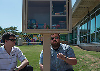 """NWA Democrat-Gazette/ANTHONY REYES @NWATONYR<br /> Blake Murray (left) and Hunter Rogers, with The Jones Center, check the installation of a """"Little Free Pantry"""" Monday, May 8, 2017 at the Jones Center in Springdale. Murray is a member of the 22nd class of Leadership Springdale. The pantry is the Leadership class' special project they designed, raised the money for and installed. The group installed five pantries around Springdale. One each at the Jones Center, Springdale Housing Authority, Springdale Police Department, Elmdale Baptist Church and the Iglecia Ministerio Pentecostal."""