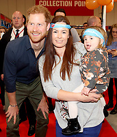 19 April 2017 - Prince Harry meets a mother and her young child as he officially opens the Virgin Money London Marathon Expo at ExCel in London. Prince Harry, who is Patron of the London Marathon Charitable Trust, will meet runners and hand out race numbers, along with special edition Heads Together headbands, which is the official Charity of the Year for this year's marathon. Photo Credit: ALPR/AdMedia