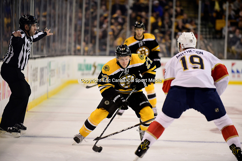 Monday, December 5, 2016: Boston Bruins center Austin Czarnik (27) plays the puck in his offensive zone during the National Hockey League game between the Florida Panthers and the Boston Bruins held at TD Garden, in Boston, Mass. Eric Canha/CSM