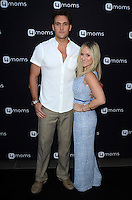 LOS ANGELES, CA - AUGUST 4: Owain Yeoman, Gigi Yallouz at the 4Moms launch of the world's first self-installing car seat at Petersen Automotive Museum in Los Angeles, California on August 4, 2016. Credit: David Edwards/MediaPunch