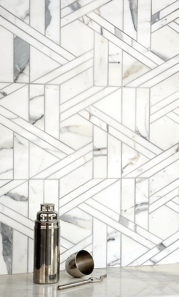Hector Grand, a stone waterjet mosaic, shown in Calacatta Tia honed, is part of the Altimetry® Collection for New Ravenna.