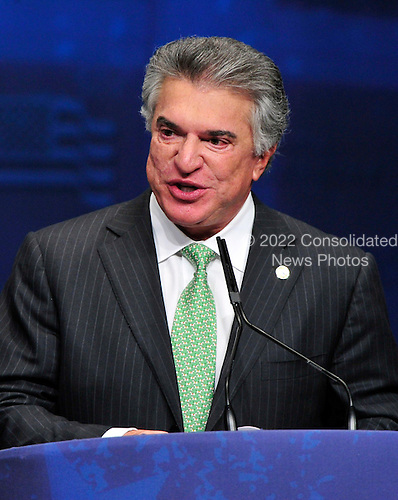 Al Cardenas, Chairman, the American Conservative Union, introduces former Governor Mitt Romney (Republican of Massachusetts), a candidate for the 2012 Republican Party nomination for President of the United States, at the 2012 CPAC Conference at the Marriott Wardman Park Hotel in Washington, D.C. on Friday, February 10, 2012..Credit: Ron Sachs / CNP
