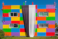 In memory and respect of the Thai King Bhumibol Adulyadej a Ribbon is hanging down at this colorful Building a Garment Factory located on the Highway outside Phitsanulok in Central Thailand
