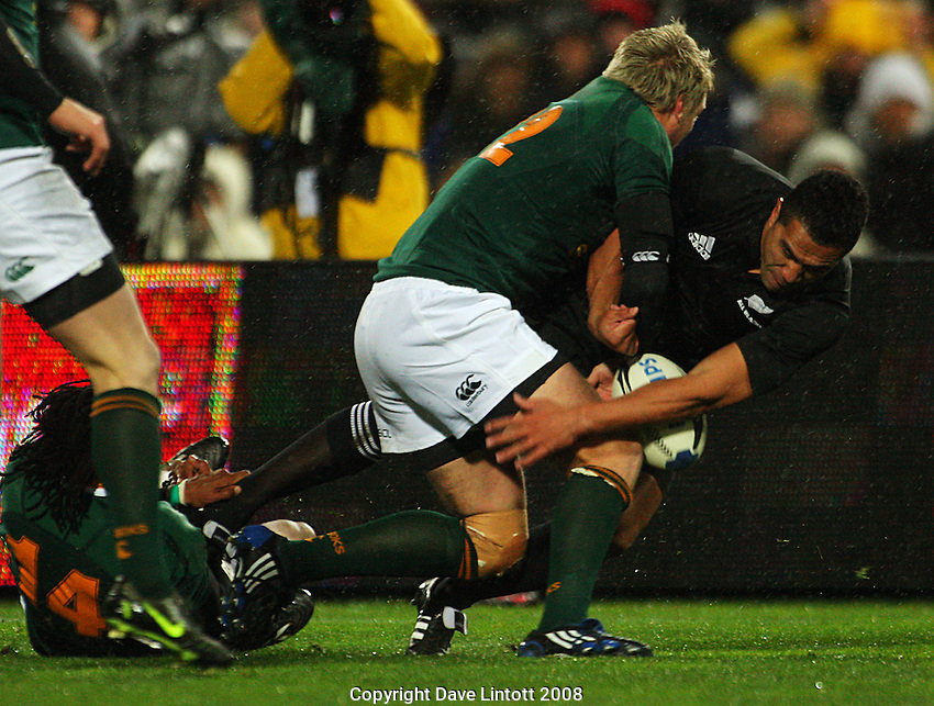 Mils Muliaina loses the ball in Jean De Villiers' tackle..Philips Tri Nations, All Blacks vs South Africa at Westpac Stadium, Wellington, New Zealand, Saturday 5 July 2008. Photo: Dave Lintott/lintottphoto.co.nz