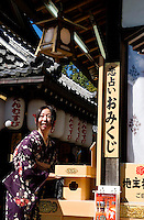 A woman in traditional Japanese costume gets ready for a photoshoot in Kiyomizu-dera temple, in Kyoto, Japan, on October 6, 2010. Photo by Lucas Schifres/Pictobank