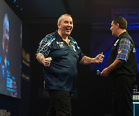 04.01.2015.  London, England.  William Hill PDC World Darts Championship.  Finals Night.  Gary Anderson (4) [SCO] and Phil Taylor (2) [ENG] during their match.