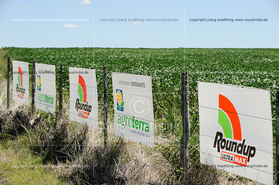 URUGUAY  Monsanto GMO (gene modified organism) soya bean field and roundup pesticide banner, soja beans are exported to China for animal fodder for pig, chicken etc / URUGUAY Grossflaechiger Anbau von Monsanto Gensoja fuer Futtermittel Export nach China zur Mast von Schweinen Huehnern usw., Plakate des Pflanzenschutzmittel Roundup von Monsanto