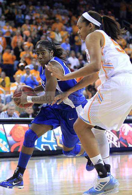 Junior guard Victoria Dunlap avoids Tennessee's Kelley Cain during the second half of the UK women's basketball game against Tennessee for the SEC tournament at the Gwinnett Center on Sunday, March 7, 2010. UK lost to Tennessee  70-62. Photo by Adam Wolffbrandt | Staff