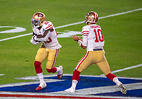 2nd February 2020, Miami Gardens, Florida, USA;  San Francisco 49ers Quarterback Jimmy Garoppolo (10) hands off the ball to San Francisco 49ers Running Back Tevin Coleman (26) during the NFL Super Bowl LIV  game between the Kansas City Chiefs and the San Francisco 49ers at the Hard Rock Stadium in Miami Gardens