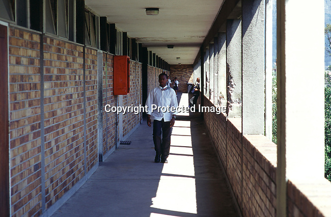 EDSECON19077.Education. Secondary. KwaZulu Natal. School boy walking down a corridor ni front of classrooms. 99. School uniform. .©Per-Anders Pettersson / iAfrika Photos