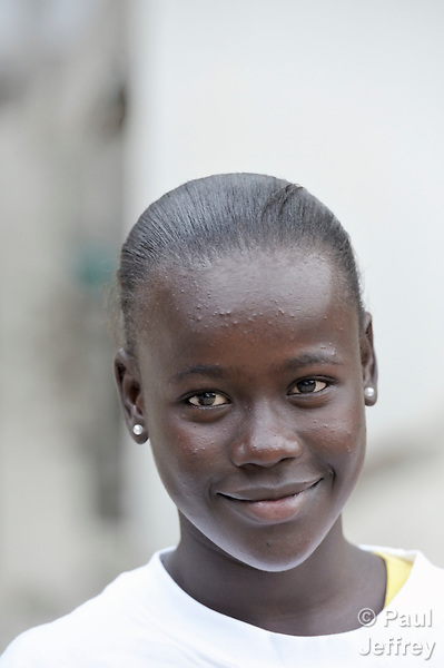 Christina LeConte, 15, participates in activities at a youth center run by the YWCA in Petionville, Haiti. The program educates and empowers girls, many of whom don't go to school, who come from families affected by the January 2010 earthquake. Many live in tents that fill a nearby park.