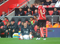 Burnley's Johann Gudmundsson reacts after being hauled down by Southampton's Jack Stephens<br /> <br /> Photographer Kevin Barnes/CameraSport<br /> <br /> The Premier League - Southampton v Burnley - Sunday August 12th 2018 - St Mary's Stadium - Southampton<br /> <br /> World Copyright &copy; 2018 CameraSport. All rights reserved. 43 Linden Ave. Countesthorpe. Leicester. England. LE8 5PG - Tel: +44 (0) 116 277 4147 - admin@camerasport.com - www.camerasport.com