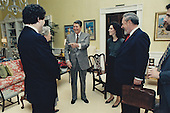 United States President Ronald Reagan, center, joins Judge Robert H. Bork, his nominee for Associate Justice of the U.S. Supreme Court to replace Justice Lewis Powell, 2nd right, and his family in the Residence of the White House in Washington, D.C. following the President's meeting with Judge Bork on October 9, 1987. Talking with the President from left to right: Robert H. Bork, Jr., Mrs. Mary Ellen Bork, Ellen E. Bork, and Charles E. Bork..Mandatory Credit: Pete Souza / White House via CNP