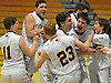 Steven Shoemaker #12 of Oyster Bay, second from right, and teammates celebrate after their 54-42 win over Wheatley in the Nassau County varsity boys basketball Class B final at LIU Post on Thursday, Feb. 18, 2016.