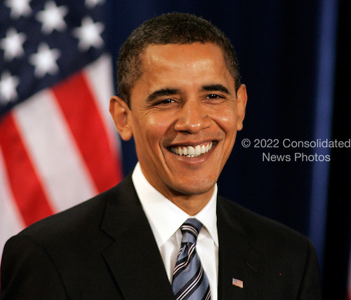 """Chicago, IL - December 11, 2008 -- United States President-elect  Barack Obama smiles while listening to a question at a news conference Thursday December 11, 2008, in Chicago, Illinois. In his remarks, Obama said he was """"appalled and disappointed"""" by the revelations this week concerning Illinois Governor Rod Blagojevich's alleged attempts to sell Obama's old United States Senate seat..Credit: Frank Polich - Pool via CNP"""