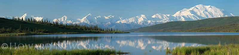 Panorama view of Mt. McKinley and the Alaska Range is mirror reflected in Wonder Lake, Denali National Park, Alaska.  This high resolution panoramic photogragh can be printed to 5 feet wide without any enlargement.