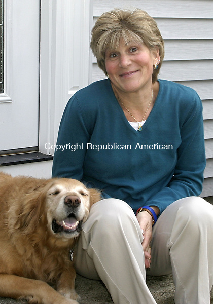 CHESHIRE, CT -08 JANUARY 2007 -010808DA02- Gina Reynolds sits with her dog Sandy in the front of her Cheshire home Tuesday. Reynolds had major brain surgery to terminate seizure that are a symptom of her epilepsy.<br /> Darlene Douty/Republican-American
