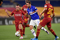 Jordan Veretout of AS Roma and Karol Linetty of UC Sampdoria compete for the ball during the Serie A football match between AS Roma and UC Sampdoria at Olimpico stadium in Rome ( Italy ), June 24th, 2020. Play resumes behind closed doors following the outbreak of the coronavirus disease. AS Roma won 2-1 over UC Sampdoria. <br /> Photo Andrea Staccioli / Insidefoto