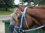 New York Post Columnist John Crudele works in the barn of Trainer Chuck Spina at Monmouth Park in Oceanport, New Jersey on Saturday July 9, 2016. Photo By Bill Denver/EQUI-PHOTO