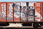 Ely Ghost Train mural (painting) on the side of a hopper car in the East Ely railyard
