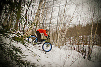 Mountain biking on snow in winter using fat bikes snow bikes on Marquette Michigan's South Trails.
