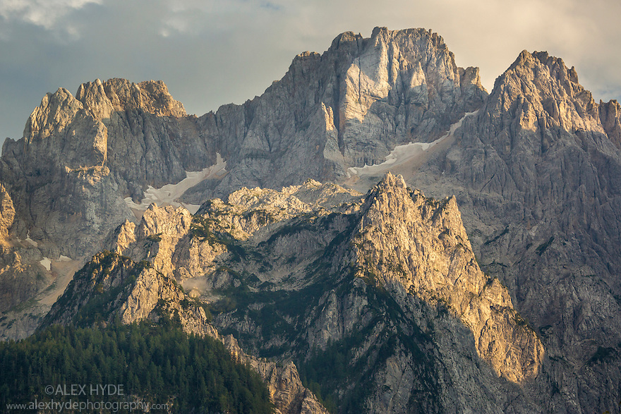 Velika Ponca (highest of the peaks shown at 2592 m) at sunset, Triglav National Park, Julian Alps, Slovenia, July.