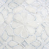 Stella, a handmade mosaic shown in honed Afyon White, tumbled Thassos and Shell, is part of the Parterre Collection by Paul Schatz for New Ravenna.