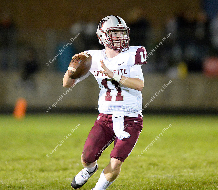 La Follette quarterback, Ben Probst, drops back to pass in the first quarter, as Madison La Follette takes on Verona in Wisconsin Big Eight Conference high school football on Friday, 10/4/19 at Verona High School's Curtis Jones Field