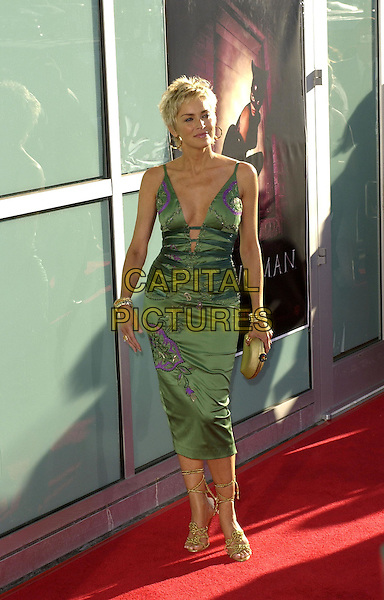 SHARON STONE.Attends Warner Brothers' World Premiere of Catwoman held at The Arclight Cinerama Dome Theatre in Hollywood, California on July 19,2004..full length green and purple low cut plunging neckline dress gold strappy wrap around sandals shoes bangles jewellery.Ref: DVS.www.capitalpictures.com.sales@capitalpictures.com.©Capital Pictures.