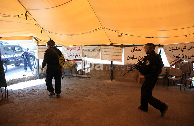 Israeli soldiers attack the protest tent in the mostly Arab neighbourhood of Silwan in east Jerusalem on April 29, 2010. Photo by Sliman Khader