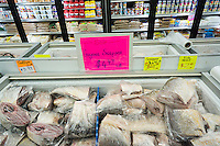 Snapper in a grocery store in Richmond Hill in the New York borough of Queens on Thursday, June 25, 2015. The neighborhood of Richmond Hill is a polyglot of ethnic cultures. It is home to Pakistanis, Indians, Guyanese and has a large Sikh population.  (© Richard B. Levine)