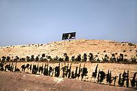 A billboard showing President Bashar al-Assad, is displayed above the Mashru Dummar neighbourhood, in Damascus, Syria.