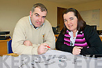Liam Brosnan and Mary B Teahan surveys plans at the Irish Drain offices in Farranfore