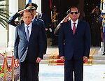 Egyptian President Abdel Fattah al-Sisi and Lebanese President Michel Aoun inspect the honor guards during the a welcome ceremony at the Presidential palace in Cairo on February 13, 2017. Aoun started his first visit to Cairo since his election in October and held talks with Sisi and religious leaders. Photo by Egyptian President Office