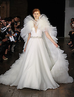 """Model walks runway in a """"Cherish"""" bridal gown from the Rivini by Rita Vinieris Fall 2017 collection on October 7th, 2016 during New York Bridal Fashion Week."""