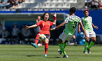 GRENOBLE, FRANCE - JUNE 12: Mina Lee #7 of the Korean National Team attempts to block a pass by Osinachi Ohale #3 of the Nigerian National Team during a game between Korea Republic and Nigeria at Stade des Alpes on June 12, 2019 in Grenoble, France.