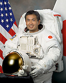 Houston, TX - (FILE) -- March 19, 2007 file photo of Japan Aerospace Exploration Agency (JAXA) astronaut Koichi Wakata, flight engineer, STS-119, scheduled for launch no earlier than February 27, 2009.  Space shuttle Discovery will deliver the International Space Station's fourth and final set of solar arrays, completing the station's backbone, or truss structure.  The arrays will provide enough electricity to power science experiments and support the station's expanded crew of six. Altogether, the station's arrays can generate about 120 kilowatts of usable electricity -- enough to provide about 42 2,800-square-foot homes with power. The 14-day flight will include four spacewalks, lasting about 6.5 hours each, to help install the S6 truss segment to the right side of the station. STS-119 is the 125th space shuttle flight, the 28th flight to the station, the 36th flight of Discovery, and the first flight in 2009.  Wakata will remain on the station, replacing Expedition 18 Flight Engineer Sandra Magnus, who returns to Earth with the STS-119 crew. He will serve as a flight engineer for Expeditions 18 and 19, and he will return to Earth on shuttle mission STS-127.  .Credit: NASA via CNP
