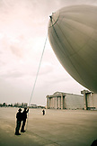 USA, California, San Francisco, man directing the nose of the Airship Ventures Zeppelin at the landing pad