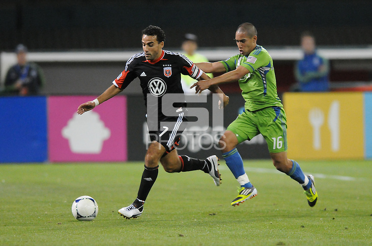 D.C. United forward Dwayne De Rosario (7) shields the ball against Seattle Sounders forward David Estrada (16)  D.C. United tied the Seattle Sounders, 0-0 at RFK Stadium, Saturday April 7, 2012.