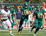 SEPTEMBER 13, 2014 -- Anthony Eboreime #18 of Black Hills State finds running room past South Dakota Mines linebacker Jay Lata #3 during their college football game Saturday at Lyle Hare Stadium in Spearfish, S.D.  At right is Richard Nava #67 of Black Hills State.  (Photo by Dick Carlson/Inertia)
