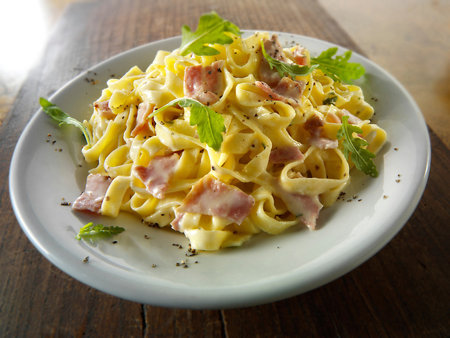Tagliatelli pasta carbonara -pasta with a creamy cheese sauce and bacon