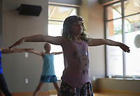 "NWA Democrat-Gazette/CHARLIE KAIJO Edelweiss Pace, 7, performs a stretch during a kids yoga class, Monday, July 8, 2019 at Yoga Story in Bentonville. <br /> <br /> ""It helps them to learn to breath, pay attention to their bodies, work through emotions and sensations,"" said instructor Kari Pace describing the benefits of yoga for kids. ""I was a very anxious kid so it would have been nice to have a technique like this. It's fun to share it with my kids and other kids."""