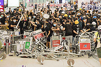 CHINA, Hong Kong: 13 August 2019 <br /> Demonstrators form a barricade as they clash with riot police at Hong Kong International Airport. Demonstrators have taken to the streets of Hong Kong in protest of a controversial extradition bill since 9th of June which has resulted in several violent clashes.<br /> Rick Findler / Story Picture Agency