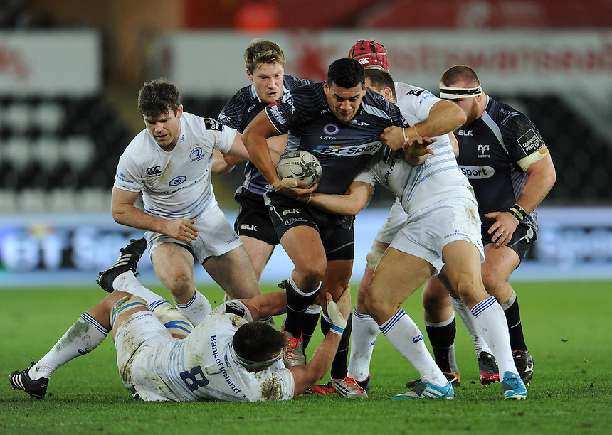 Ospreys' Josh Matavesi is tackled by Leinster's Jack Conan and Jimmy Gopperth<br /> <br /> Photographer Ian Cook/CameraSport<br /> <br /> Rugby Union - Guinness PRO12 - Ospreys V Leinster - Friday 27th February 2015 - Liberty Stadium - Swansea<br /> <br /> &copy; CameraSport - 43 Linden Ave. Countesthorpe. Leicester. England. LE8 5PG - Tel: +44 (0) 116 277 4147 - admin@camerasport.com - www.camerasport.com