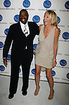 SANTA MONICA, CA. - September 10: Antwone Fisher and Sharon Stone  arrive at the A Smile for Every Child Gala at the Hotel Shangri-La on September 10, 2009 in Santa Monica, California.