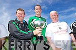 Aidan O'Callaghan Castleisland Captain receiving the Greyhound Bar KO Cup after defeating Listowel Celtic at Mounthawk Park on Sunday also in pic Sean O'Keeffe and John O'Regan.