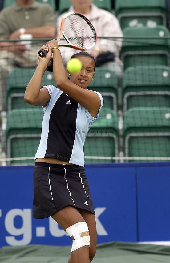 Photo. Daniel Hambury..The Surbiton Trophy..02/06/05..Anne Keothavong plays a back hand during her match with Laura Granville. The British girl retired in the second set with a knee injury.