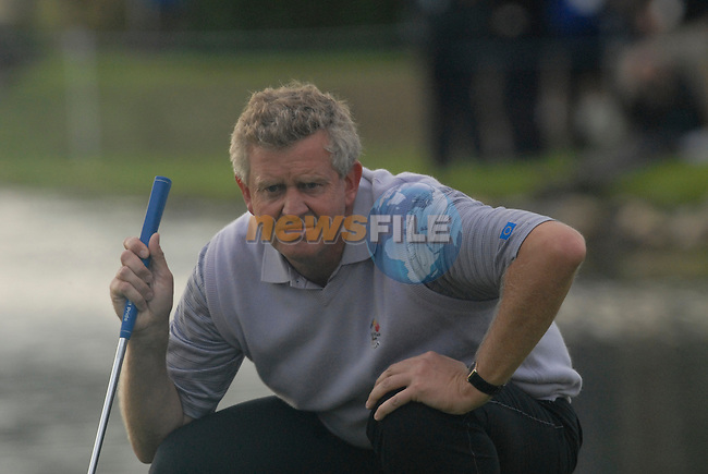 23rd September, 2006. .European Ryder Cup Team player Colin Montgomerie lines up his putt on the 18th green during the afternoon foursomes session of the second day of the 2006 Ryder Cup at the K Club in Straffan, County Kildare in the Republic of Ireland..Photo: Eoin Clarke/ Newsfile.