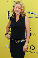 SANTA MONICA, CA, USA - NOVEMBER 16: Megyn Price arrives at the P.S. ARTS Express Yourself 2014 held at The Barker Hanger on November 16, 2014 in Santa Monica, California, United States. (Photo by Celebrity Monitor)